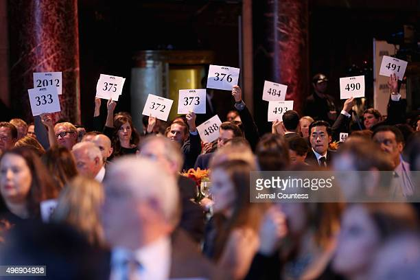 Guests participate in an auction at the 9th Annual IAVA Heroes Gala at the Cipriani 42nd Street on November 12 2015 in New York City