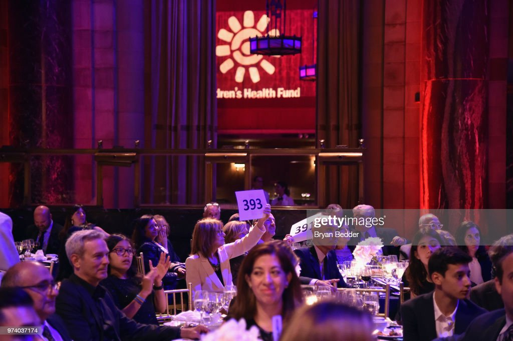 Guests participate in an auction during the Children's Health Fund 2018 Annual Benefit at Cipriani 42nd Street on June 13, 2018 in New York City.