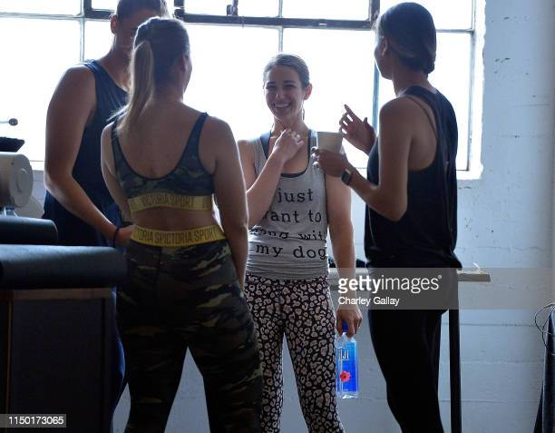 Guests participate in group exercise during FIJI Water at SHAPE Body Shop 2019 at Hudson Loft on June 15 2019 in Los Angeles California