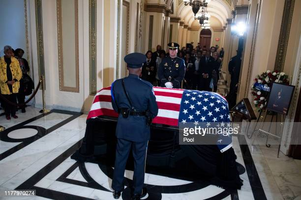 Guests pay respects to the late Rep. Elijah Cummings as his remains lie in state outside the House Chamber of the U.S. Capitol October 24, 2019 in...