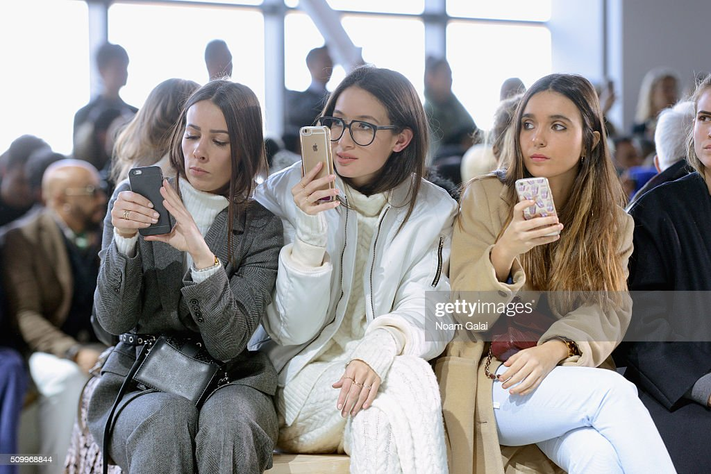 Guests photograph the Lacoste Fall 2016 fashion show during New York Fashion Week at Spring Studios on February 13, 2016 in New York City.