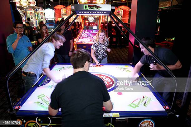 Guests play arcade games at Dave & Buster's Hollywood & Highland Grand Opening on August 21, 2014 in Hollywood, California.