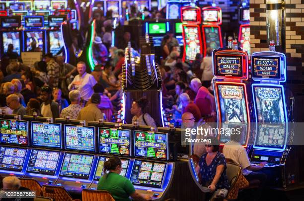Guests play electronic slot machines at the MGM Springfield LLC Casino and Resort in Springfield, Massachusetts, U.S., on Friday, Aug. 24, 2018. The...