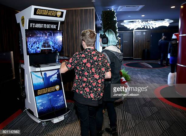 Guests play Guitar Hero during 1067 KROQ Almost Acoustic Christmas 2015 at The Forum on December 12 2015 in Los Angeles California