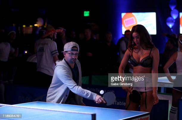 Guests play ping pong during the 13th annual Ping Pong Palooza Charity Tournament benefitting The Sapphire Foundation for Prostate Cancer at Sapphire...