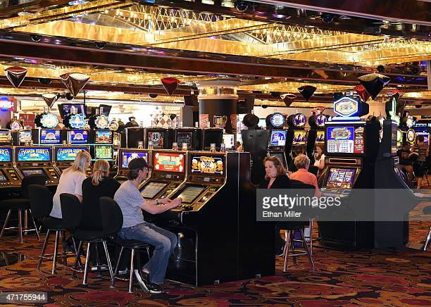 Guests play slot machines on the casino floor at the Riviera Hotel Casino on April 30 2015 in Las Vegas Nevada The Las Vegas Convention and Visitors...
