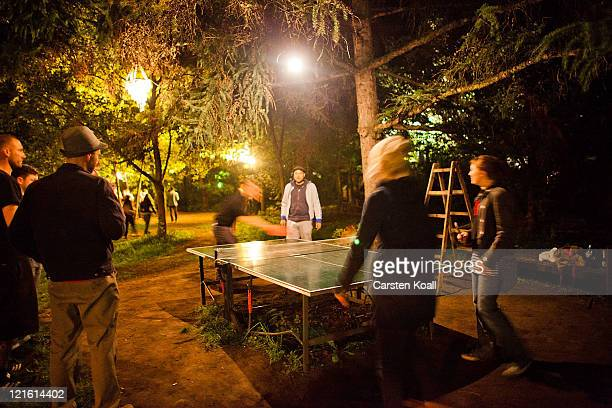 Guests play table tennis as they spending the night in the beach bar Kiki Blofeld in the early morning hours of August 21 2011 in Berlin Germany...