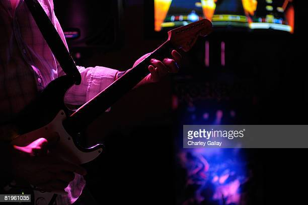Guests play the Harmonix music video game 'Rock Band 2' during the Harmonix and MTV games Rock Band party at the Orpheum Theater on July 16 2008 in...