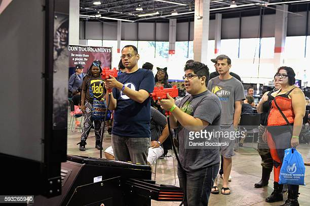 Guests play video games during Wizard World Comic Con Chicago 2016 Day 4 at Donald E Stephens Convention Center on August 21 2016 in Rosemont Illinois
