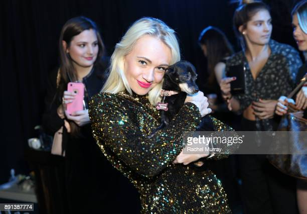 Guests play with puppies from the The Vanderpump Dog Foundation during the Sephora Collection #Lipstories launch at Sephora Studios LA on December 12...