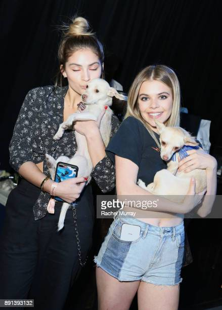 Guests play with puppies from The Vanderpump Dog Foundation during the Sephora Collection #Lipstories launch at Sephora Studios LA on December 12...