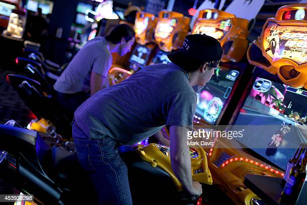 Guests playing arcade games at Dave & Buster's Hollywood & Highland Grand Opening on August 21, 2014 in Hollywood, California.