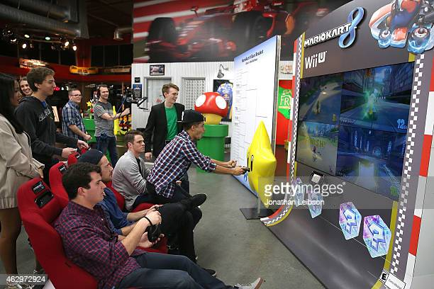 Guests playing MarioKart at the Dylan Riley Snyder Races Into His 18th Year With Nintendo at K1 Speed on February 7 2015 in Gardena California