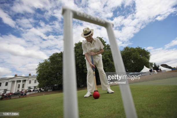 A guests plays croquet at the 'Salon Prive' luxury and supercar event held at the Hurlingham Club on July 21 2010 in London England The annual three...