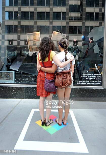Guests pose as Polaroid Grey Label by Haus of Gaga window display is unveiled at the Bloomingdale's 59th Street Flagship on May 26 2011 in New York...