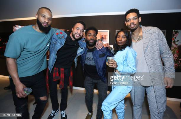 Guests pose at the Bacardi No Commission Marquee Performance hosted by Swizz Beatz and The Dean Collection at Faena Forum as part of the 2018 Art...