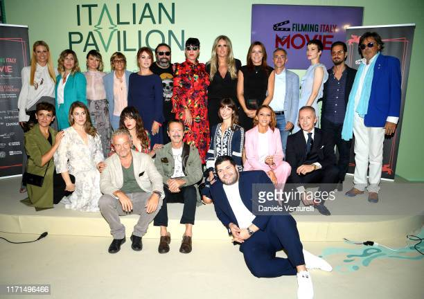 Guests pose during the Filming in Italy press conference during the 76th Venice Film Festival at Excelsior Hotel on September 01 2019 in Venice Italy