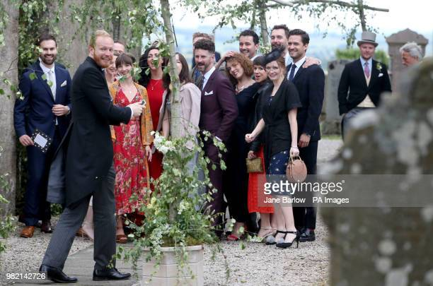 Guests pose for a group photograph including Ben Aldridge at Rayne Church Kirkton of Rayne in Aberdeenshire for the wedding ceremony of Game Of...