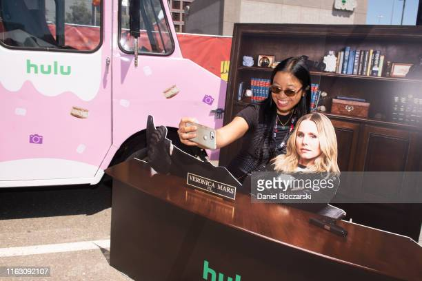"""Guests pose for photos during Hulu's """"Veronica Mars"""" Coolhaus activation during SDCC 2019 at PETCO Park on July 19, 2019 in San Diego, California."""