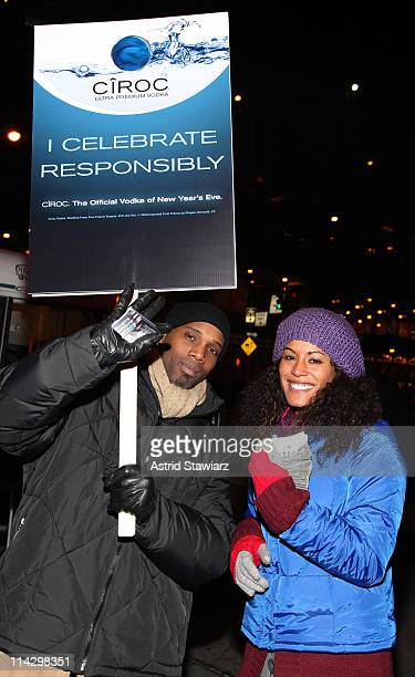 Guests pose for photos during the distribution of Ciroc debit cards for yellow cab fares on New Year's Eve hosted by Ciroc Vodka on December 31, 2008...