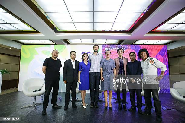 Guests pose for photos during the Urban Image of the Times International Summit Forum of the OneMinute Film Competition during the 22nd Shanghai TV...
