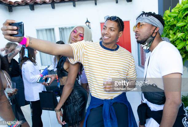 Guests pose for selfie portrait at beGlammed Sunset Soiree Presented by Fullscreen on April 12 2019 in Palm Springs California