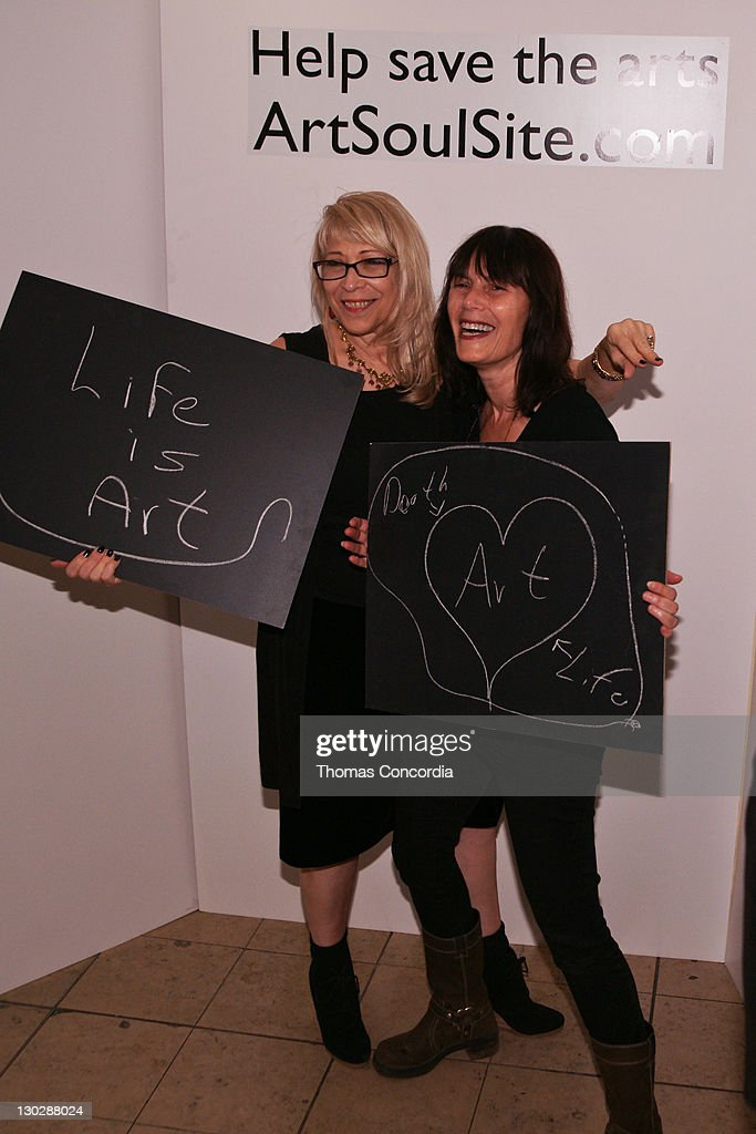 Guests pose in the photo booth to support the arts at the