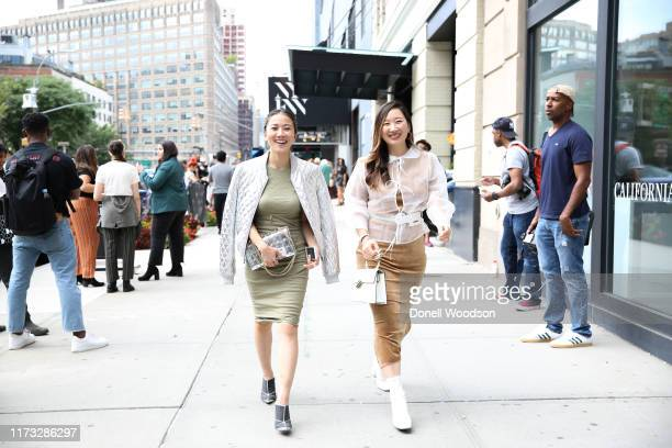 Guests pose outside of Spring Studios during New York Fashion Week on September 08, 2019 in New York City.