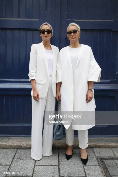 Guests pose outside the Af Vandevorst Haute Couture fashion show on July 2 2017 in Paris France