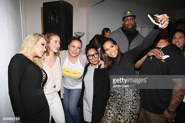 Guests pose using a TyLite at the TYLITE Launch Party at Wallplay Gallery on February 12 2016 in New York City