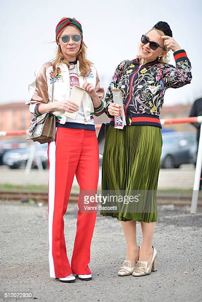 Guests pose wearing Gucci before the Gucci show during the Milan Fashion Week Fall/Winter 2016/17 on February 24 2016 in Milan Italy