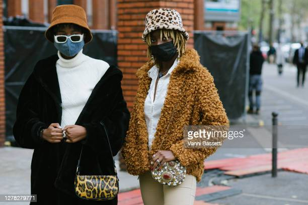 Guests pose wearing masks after the Hermes show at the Tennis Club de Paris during Paris Fashion Week - Womenswear Spring Summer 2021 on October 03,...