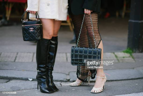 Guests pose with Chanel bags after the Chanel show at the Grand Palais during Paris Fashion Week Womenswear Fall/Winter 2020/2021 on March 03, 2020...