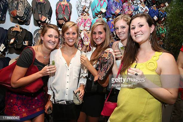 Guests pose with Havaianas displayed during the Havaianas Marie Claire Summer KickOff Event on July 18 2013 in New York City