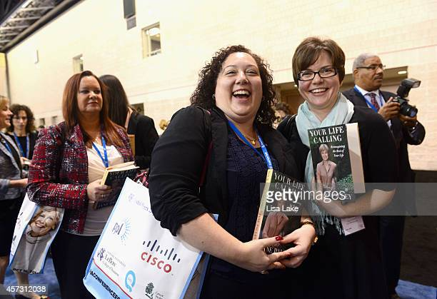 """Guests pose with newly aquired book written by Jane Pauley """"Your Life Calling"""" as they attend 2014 Pennsylvania Conference For Women at Philadelphia..."""