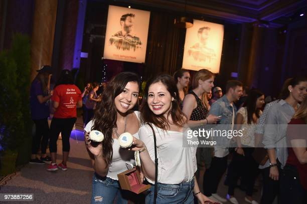 Guests pose with Pandora branded cupcakes at Pandora Up Close With Dierks Bentley Sponsored By Southwest on June 13 2018 in New York City