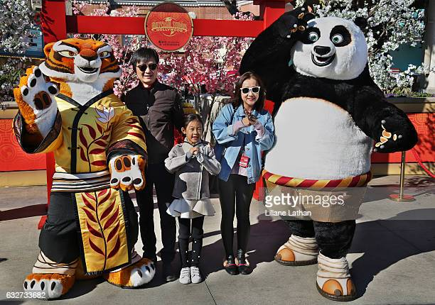 Guests pose with Tigress and Po from the 'Kung Fu Panda' film series at Universal Studios Hollywood on January 25 2017 in Universal City California