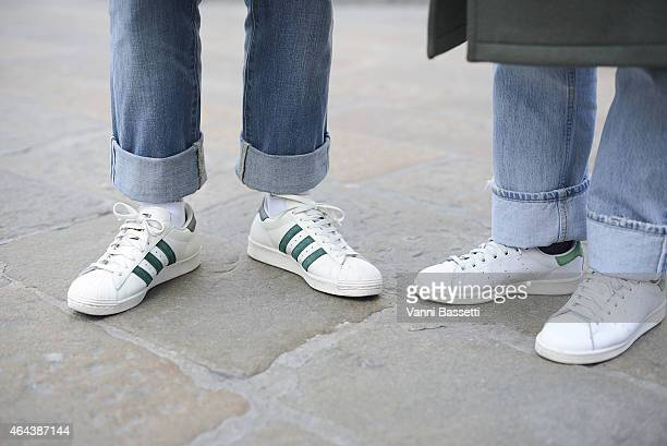 Guests poses wearing Adidas Superstar and Adidas Stan Smith shoes on February 25 2015 in Milan Italy