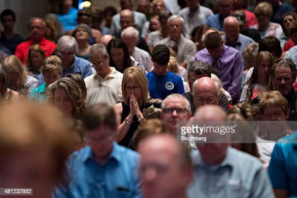Guests pray during The Family Leadership Summit in Ames Iowa US on Saturday July 18 2015 The sponsor The FAMiLY LEADER is a 'profamily promarriage...