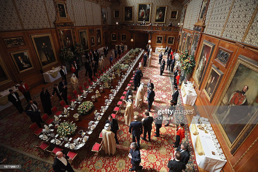 Guests prepare to take their seats for a State Luncheon for The President of the United Arab Emirates, His Highness Sheikh Khalifa bin Zayed Al Nahyan, in the Waterloo Chamber of Windsor Castle on April 30, 2013 in Windsor, England. The President of the United Arab Emirates is paying a two-day State Visit to the United Kingdom, staying in Windsor Castle as the guest of Her Majesty The Queen from April 30, 2013 to May 1, 2013. Sheikh Khalifa will meet the British Prime Minister David Cameron tomorrow at his Downing Street residence.