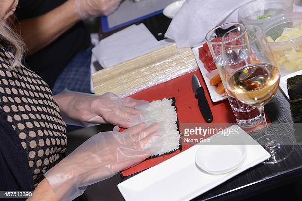 A guests prepares food with ShawRoss International Importers Chateau D'Esclans at Master Sushi Rolling Class With Morimoto during Food Network New...