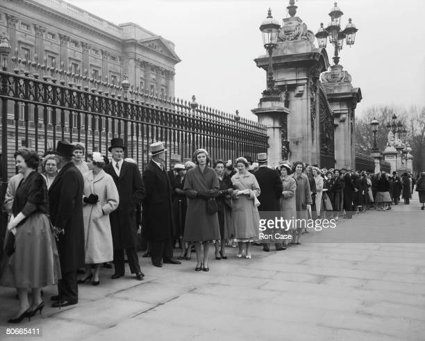 Guests queuing outside Buckingham Palace, London, to be admitted to a Presentation Party, 18th March 1958.