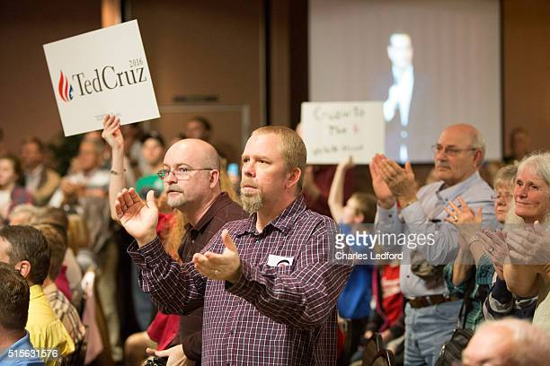 Guests react while US Senator Ted Cruz speaks at a campaign rally on March 14 2016 in Decatur Illinois The Illinois primary is March 15