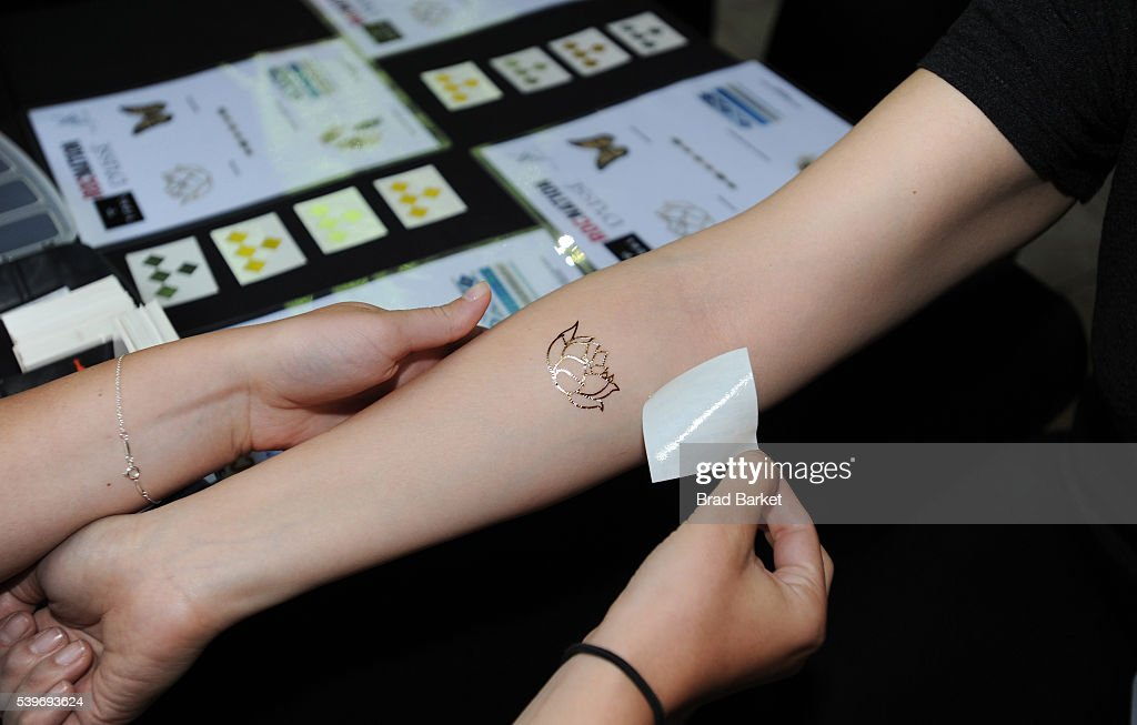 89f9ec7f37f4d Guests receive temporary tattoos as Yandel celebrates the Puerto ...