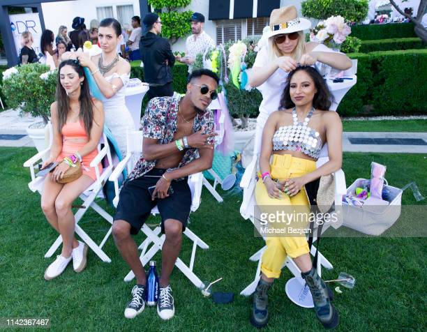 Guests receiving hair extensions at beGlammed Sunset Soiree Presented by Fullscreen on April 12 2019 in Palm Springs California