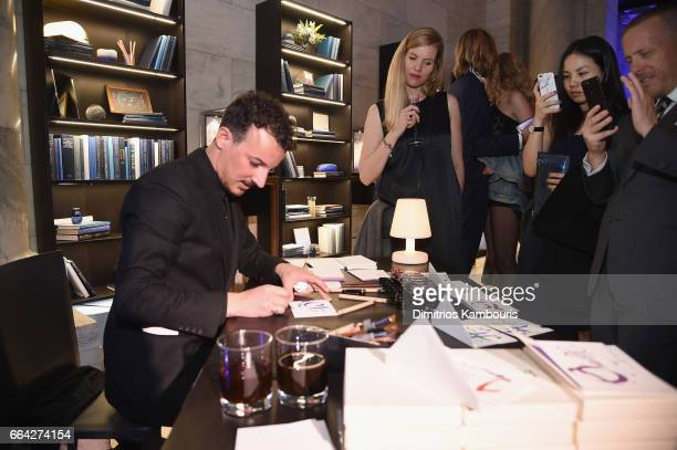 Guests recieve custom name cards by a calligrapher during the Montblanc UNICEF Gala Dinner at the New York Public Library on April 3 2017 in New York...