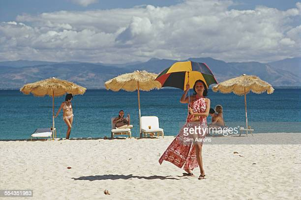 Guests relax on the beach of a private island owned by Philippine Airlines President Benigno Toda Jr Philippines February 1973