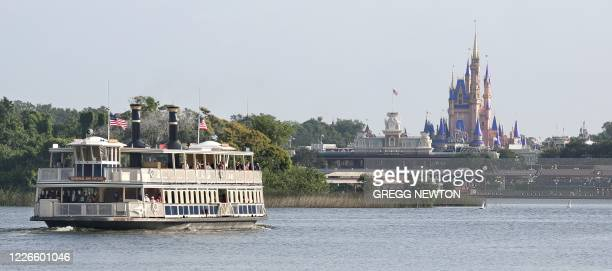 Guests ride a ferryboat to the Magic Kingdom theme park at Walt Disney World on the first day of reopening, in Orlando, Florida, on July 11, 2020. -...
