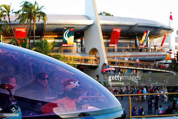 Guests ride inside the Monorail in the Tomorrowland area at Walt Diney Co's Disneyland Park part of the Disneyland Resort in Anaheim California US on...