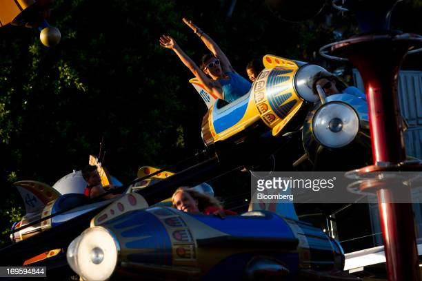 Guests ride on the Astro Orbitor in the Tomorrowland area at Walt Diney Co's Disneyland Park part of the Disneyland Resort in Anaheim California US...